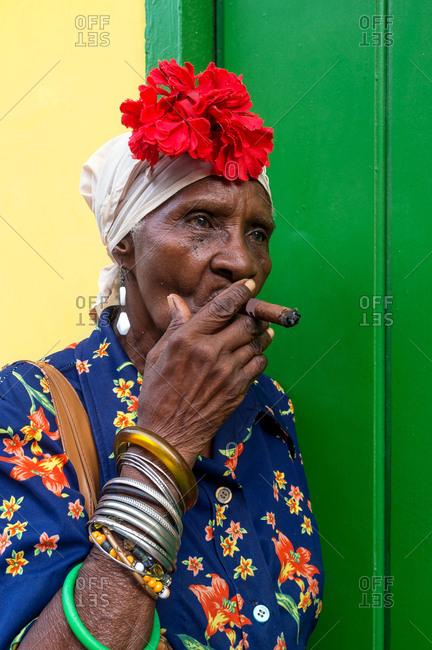 Old school Cuban lady smoking a large cigar in Havana, Cuba