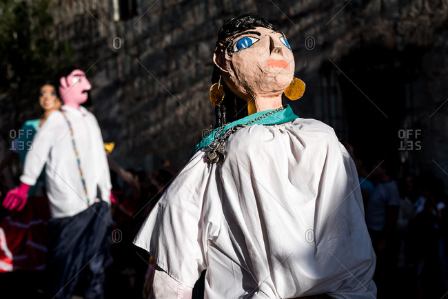 July 28, 2019: Giant paper mache puppets dance during the Guelaguetza festival in Oaxaca, Mexico