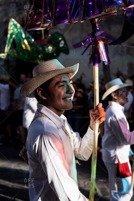 July 28, 2019: A traditionally dressed Mexican man in a parade during the Guelaguetza festival in Oaxaca, Mexico