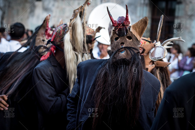 July 28, 2019: Masked performers parade in the Guelaguetza festival in Oaxaca, Mexico