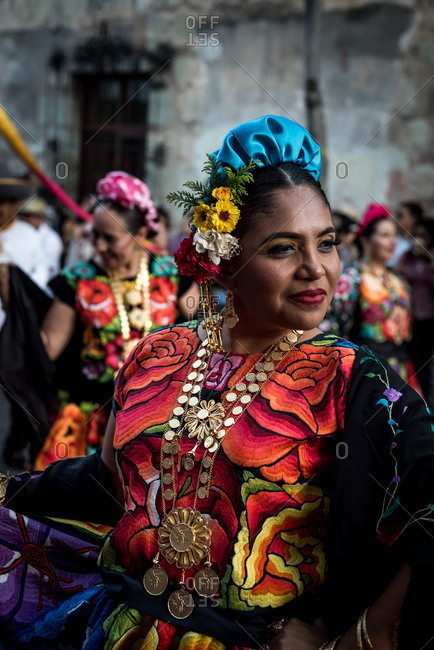 July 28, 2019: A traditionally dressed Mexican woman in a parade during the Guelaguetza festival in Oaxaca, Mexico