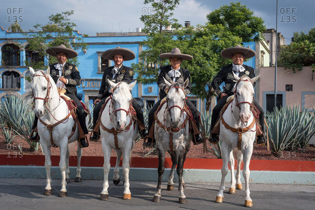 July, 23, 2019: A mariachi group riding some horses in Garibaldi Square, Ciudad de Mexico, Mexico