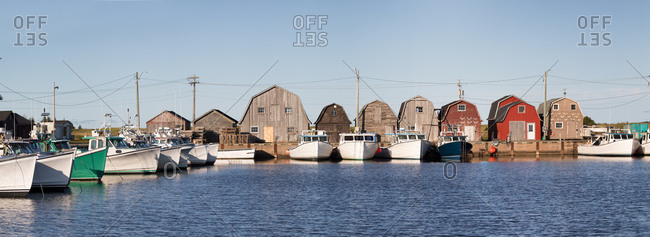 Panorama of a row of oyster barns and fishing boats at Malpeque Harbor on the north shore of Prince Edward Island (PEI) , Canada