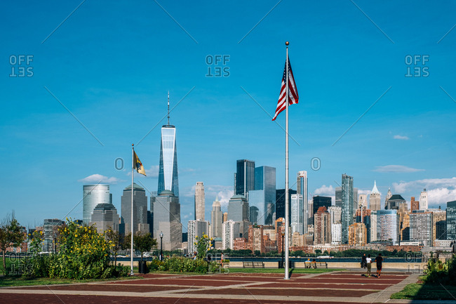 Jersey City, NJ - USA - Aug 30 2019: Lower Manhattan skyline with boat and ferry on Hudson river view from Liberty State Park in late summer