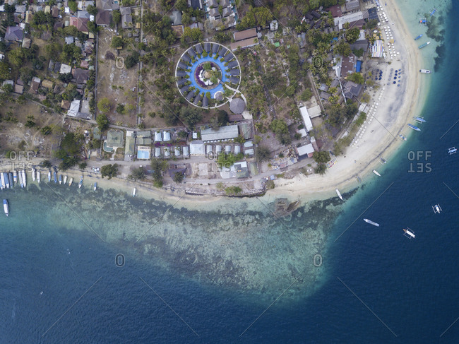 Ocean coastline and tropical resort from above, Gili Air island, Bali, Indonesia