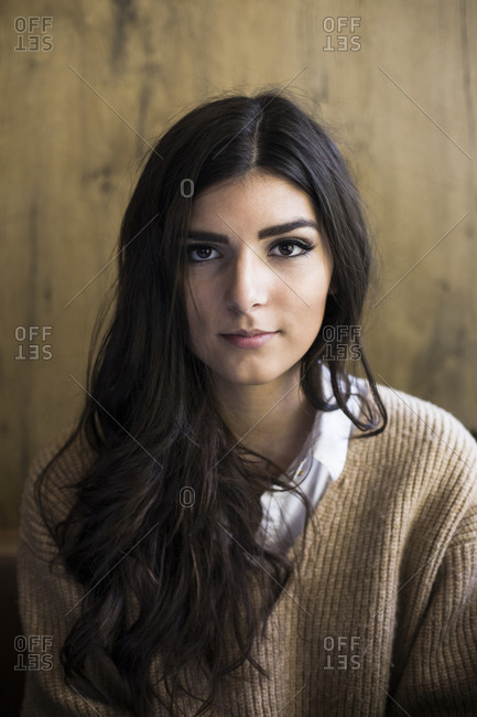 Portrait of young woman with dark long hair