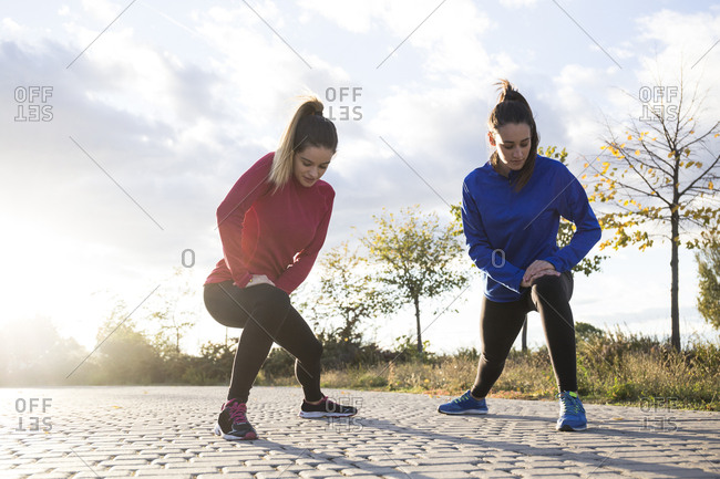 Women stretching her legs in the park