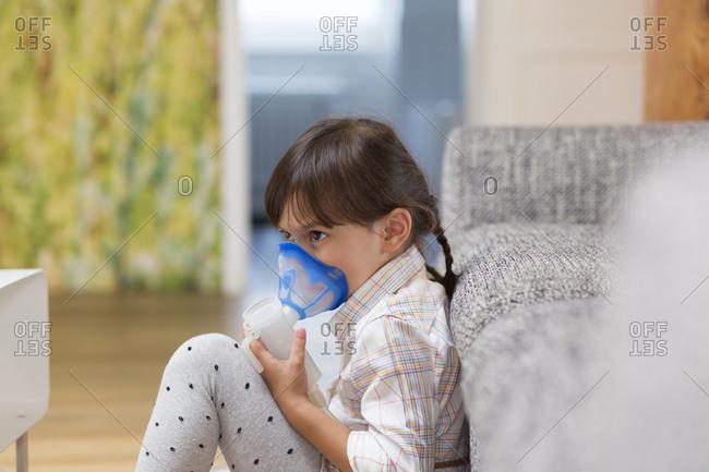 Girl using inhaler