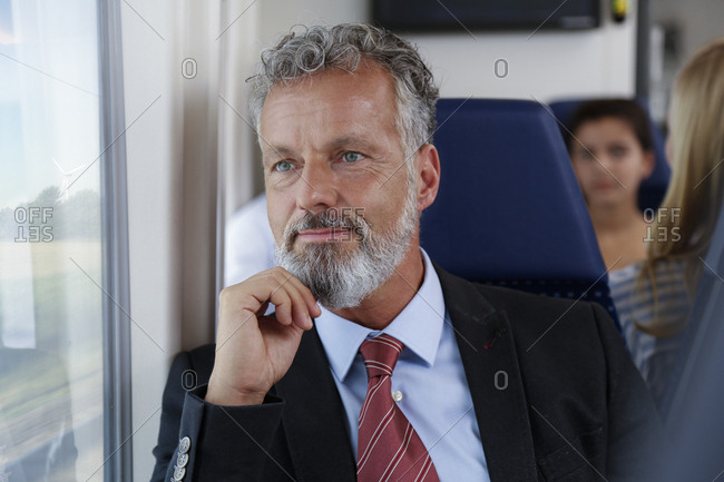 Mature businessman traveling by train
