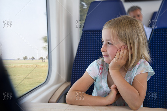 Little girl traveling by train
