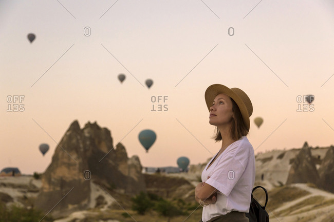 Young woman and hot air balloons- Goreme- Cappadocia- Turkey