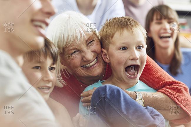 Three generations family having fun at home