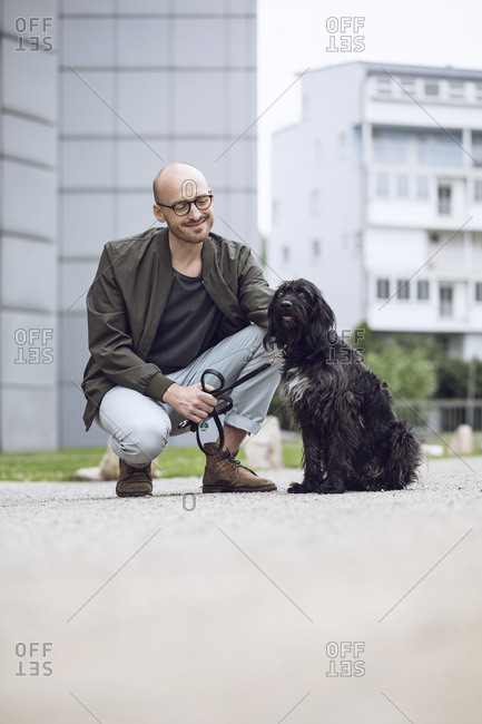 Man and his dog in the city