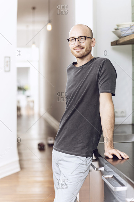 Man standing in the morning at home in the kitchen