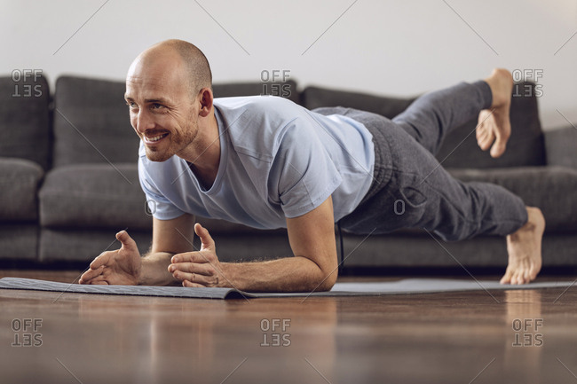 Man doing gymnastics at home