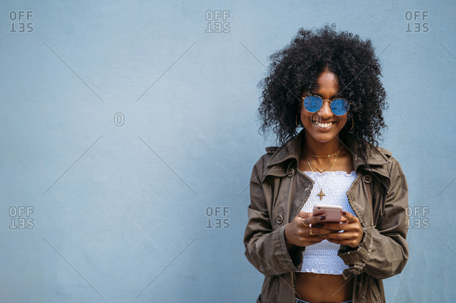 Woman using smartphone- blue background