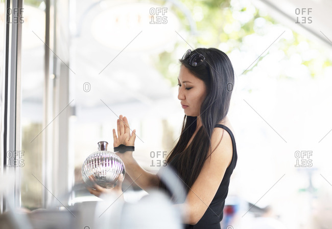 Young woman shopping- contactless payment with smartwatch