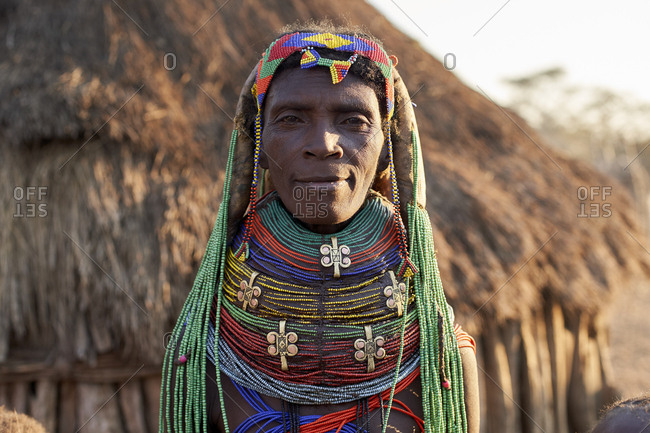 Muhila woman with her characteristic hairstyle and necklaces- Kehamba- Chibia- Angola.