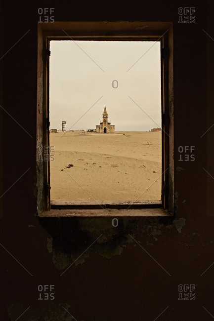 View through a window of the church at the abandoned village of Ilha dos Tigres- Angola.