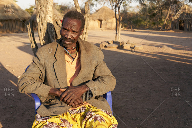 Soba of the Muhila tribe sitting on his chair- Kehamba- Chibia- Angola