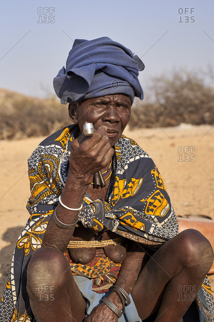 Old Mucubal tribe woman smoking her pipe-  Mucubal tribe- Tchitundo Hulo- Angola