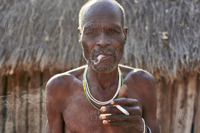 Traditional Mudimba tribe man smoking- Mudimba tribe- Canhimei- Angola