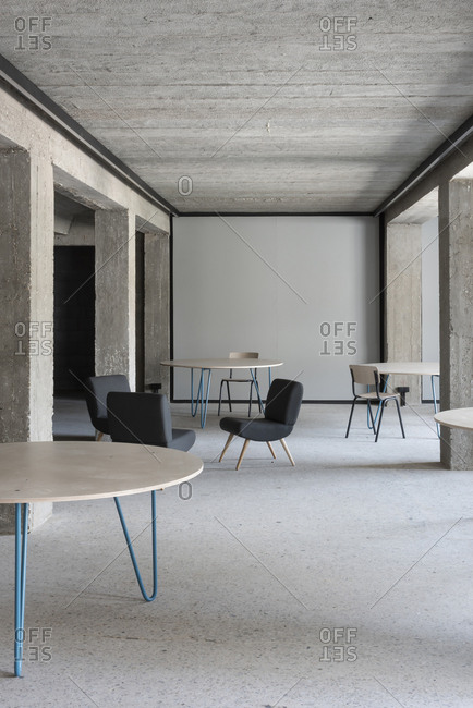 Modern furniture in a minimalist designed concrete room