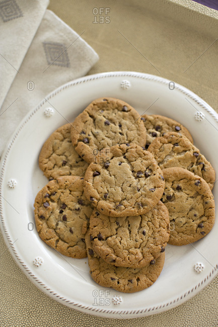 Fresh baked chocolate chip cookies on a plate