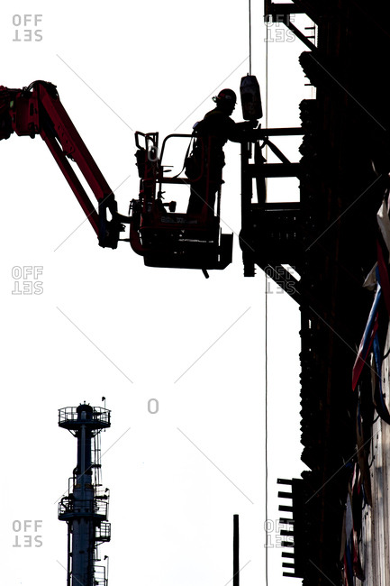 United States, Illinois, Chicago - December 19, 2011: Man working on a refinery