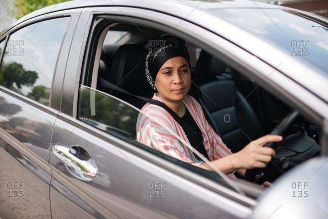 Asian woman driving car