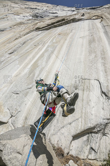 Adaptive climber ascends a rope on zodiac