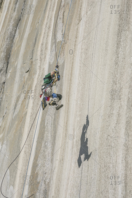 Adaptive climber pulling up on El Capitan