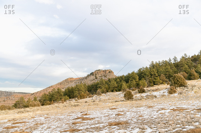 Beautiful Colorado landscape with mountains, trails and a hiker