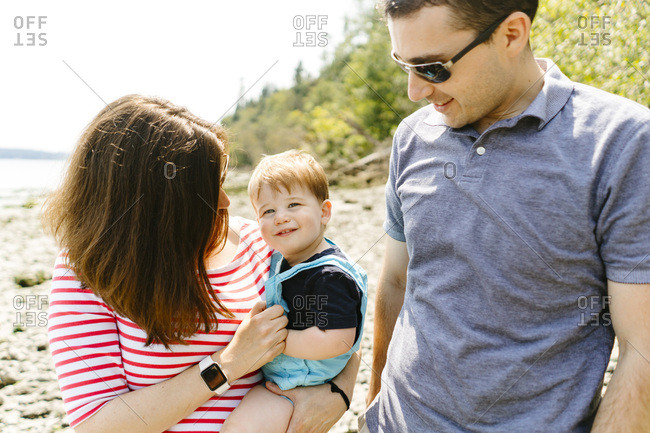 Closeup portrait of a family of three on a sunny summer day