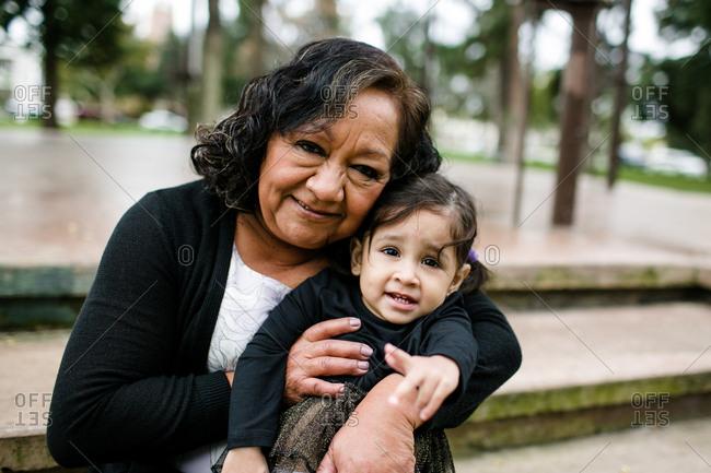 Grandmother & grand daughter hugging