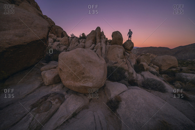 Climbing boulders at sunset near Joshua Tree