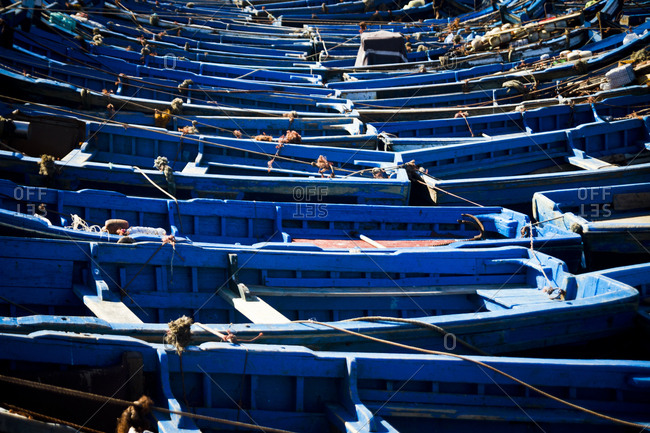 Rows of blue wooden boats at the port in Essaouira, Morocco, Africa