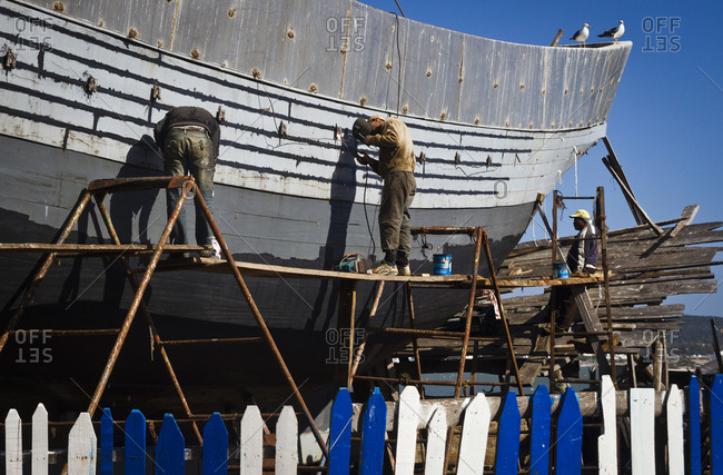 March 28, 2013: Repairing a boat in the dry dock at the port in Essaouira, Morocco, Africa