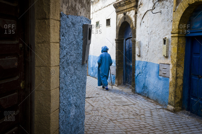 March 29, 2013: A man in a traditional robe in the streets of Essaouira, Morocco, Africa