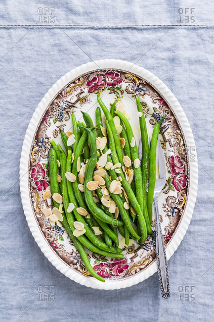 Overhead view of a plate of green beans with almonds
