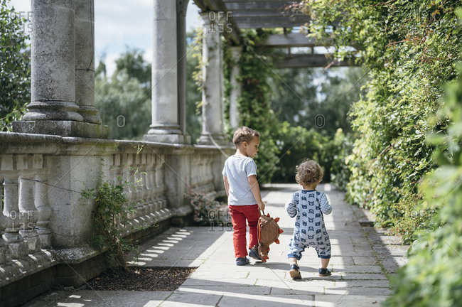 July 15, 2019: UK - London - Children walking at the pergola in Hampstead heat