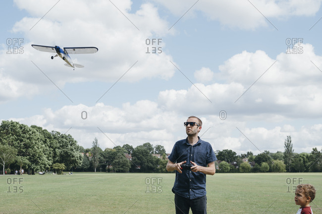 Father playing with an rc airplane