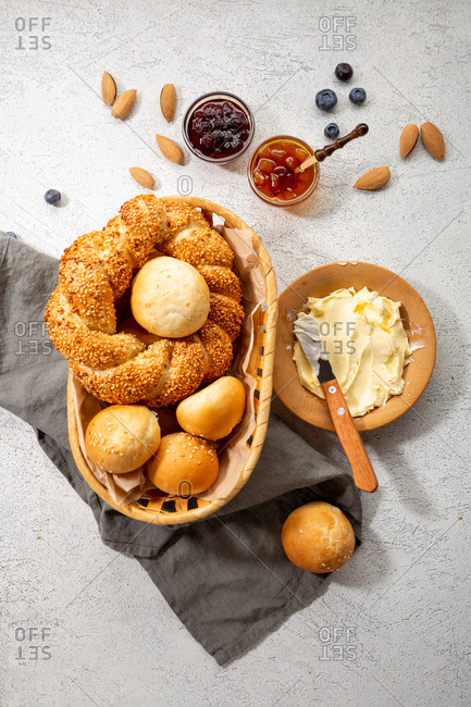 Overhead view of sesame buns in basket