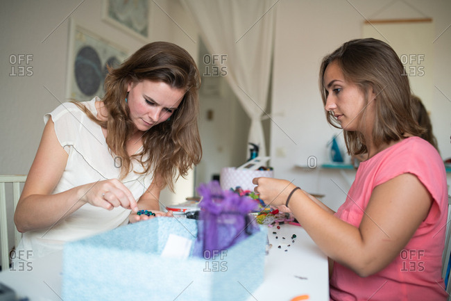 Women looking through beads and accessories while crafting