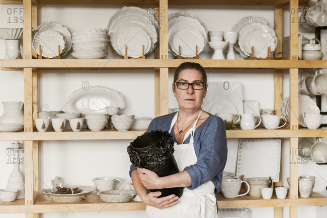 Portrait of woman holding vase
