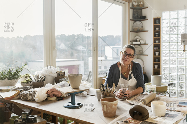 Woman at desk in pottery workshop