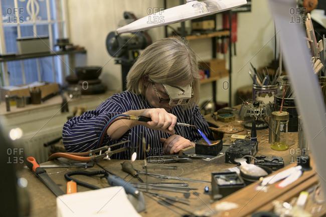 Goldsmith in her workshop