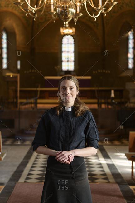 Portrait of priest in church