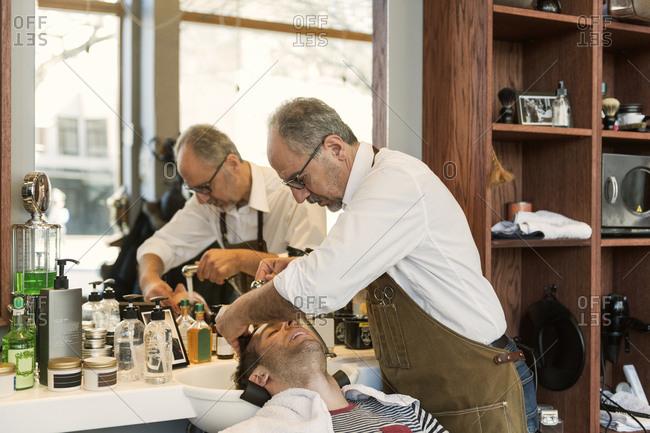Barber washing customer�s hair