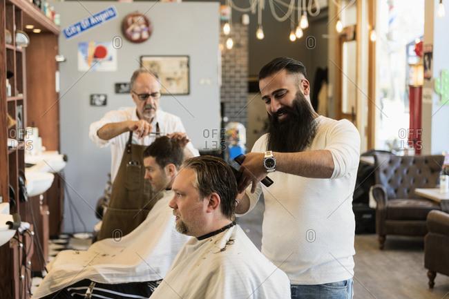 Barbers cutting customer�s hair
